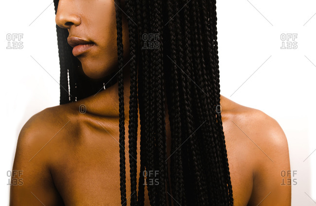 A side profile half portrait shot of a Black Ethiopian woman with braided hairstyle