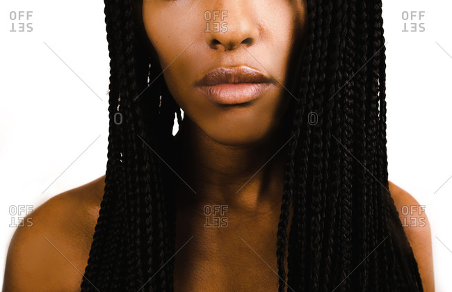 A half portrait shot of a Black Ethiopian woman with braided hairstyle