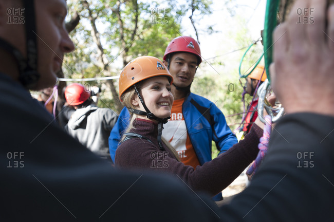 The Last Resort, Nepal - March 1, 2009: A girl receives a safety briefing for the High Ropes course in at The Last Resort in Nepal