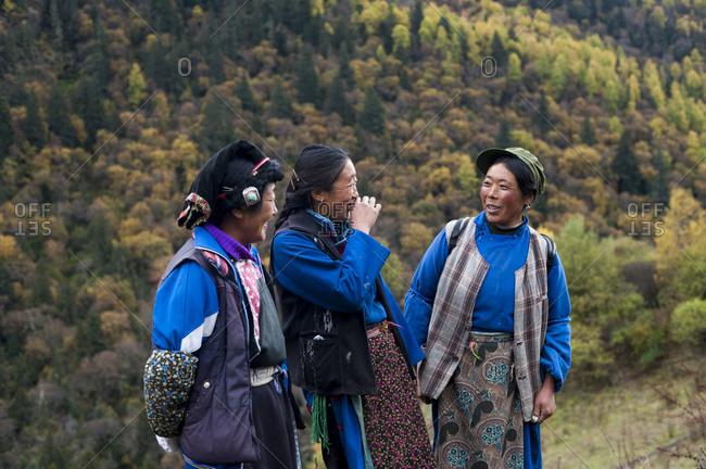 Shuangqiao valley, Mount Siguniang, Sichuan Province, China - October 22, 2009: Tibetan women from Mount Siguniang enjoy having their picture taken