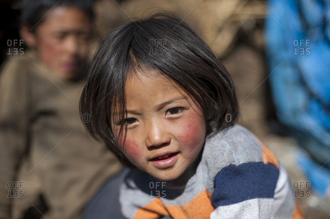 Paro, Bhutan - November 12, 2009: A little girl smiles for the camera on the Laya-Gasa trek in Bhutan