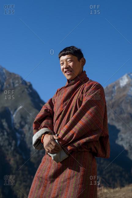 Laya, Gasa District, Bhutan - November 18, 2009: A Laya boy wearing the traditional dress called a Chuba