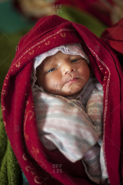 Tamghas hospital, Gulmi District, Nepal - January 7, 2010: A new born baby in a small hospital in Nepal