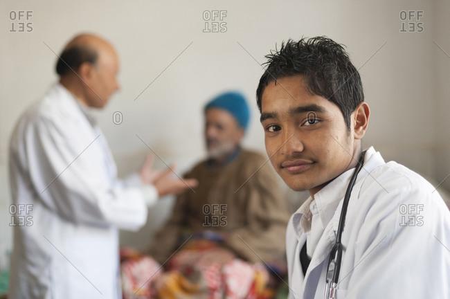 Tamghas hospital, Gulmi District, Nepal - January 7, 2010: A trainee nurse in a rural hospital in Nepal