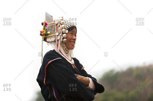 Kyaington, Keng Tung, Shan State, Myanmar - March 28, 2010: An Akha woman wearing traditional dress
