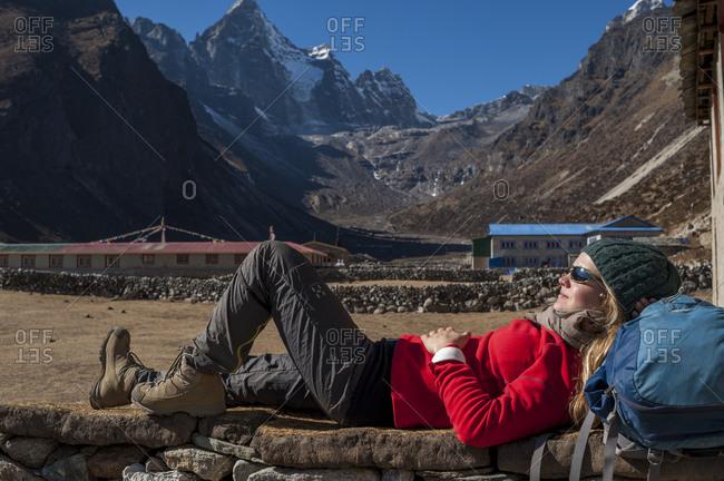 A trekker takes a break at Merchulu in the Everest region of Nepal