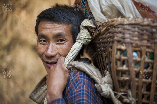 A porter carries a bamboo Doko basket in the Everest region of Nepal