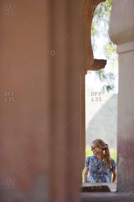 A girl enjoys walking around the ancient temples at Hampi