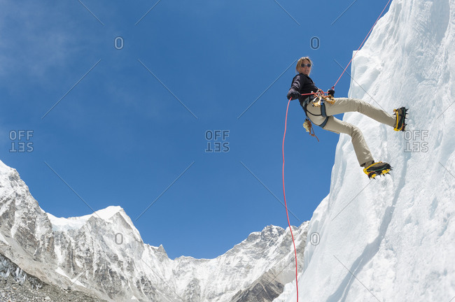 A climber makes her way down an ice wall in preperation for climbing Everest