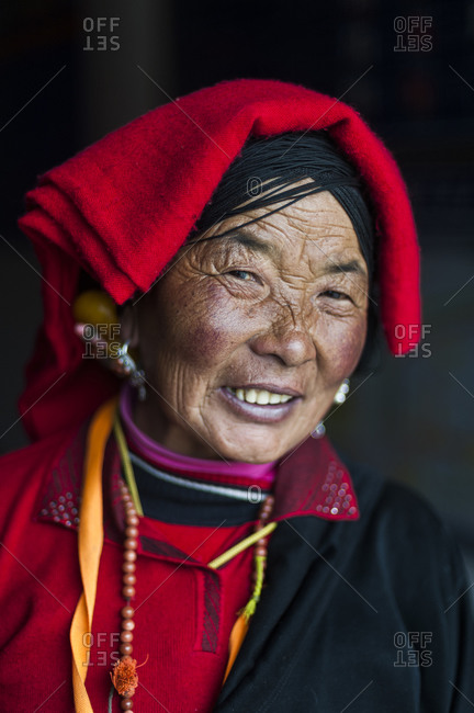 Ethnic Tibetan woman wearing traditional thread and head dress