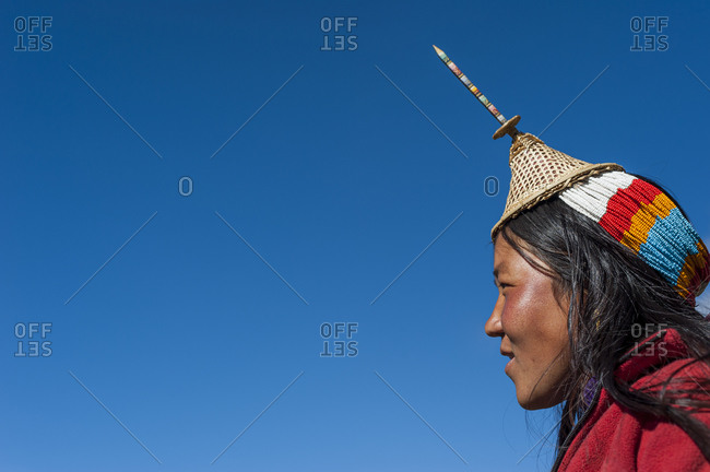 A Layap woman from the village of Laya wearing a tradition hat which features a unique spike made from bamboo