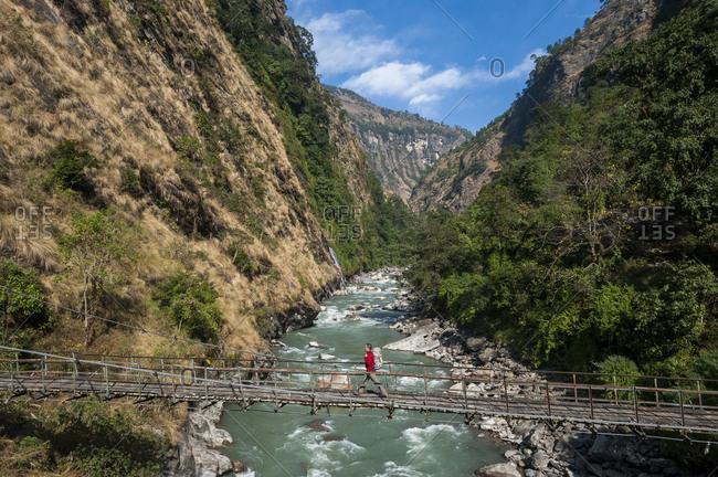 Crossing the Buri Gandaki on an old wire bridge