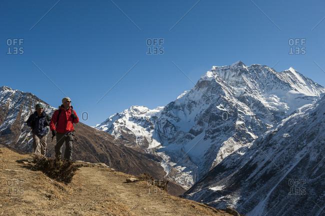 Trekkers advance towards the Larke La pass on the Manaslu circuit trek