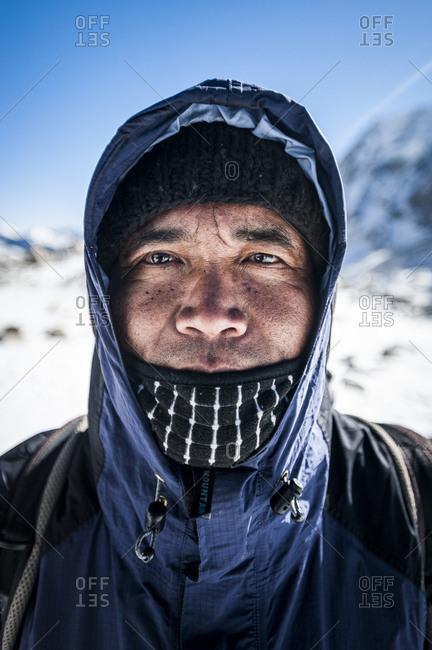 A Sherpa standing on top of the Larke La in the Manaslu region of Nepal