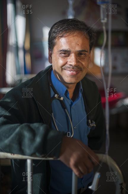 A portrait of a male doctor in a hospotal in Nepal