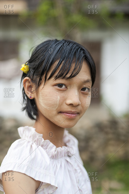 Thanaka cream, ground from tree bark, has been used by Burmese women to decorate their faces for thousands of years
