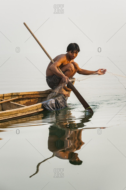 A man pulls in his net on Indawgyi lake, northern Myanmar