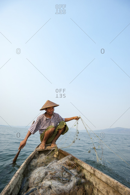 A fisherman paddles home across Indawgyi lake
