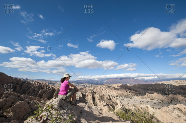 A girl looks out at the stunning landscapes of the Calchaqui valleys