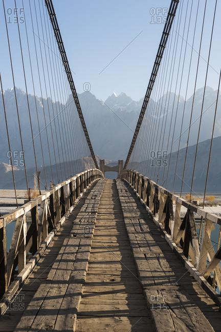 A wooden suspension bridge across the Shyok river towards Hushe