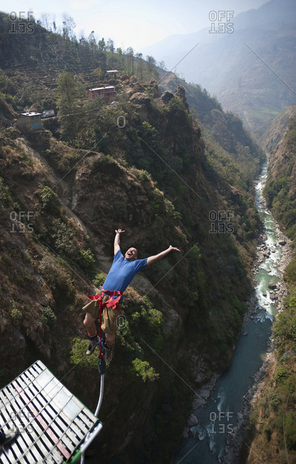 The Last Resort, Nepal - March 8, 2009: A man leaps backwards from a Bungy jumping bridge in in Nepal