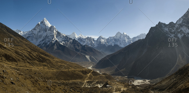 The colossal 6,182m pyramid of Ama Dablam seen here from near the Cho La pass in the Everest region and the small tea house settlement of Dugla at the bottom of the frame