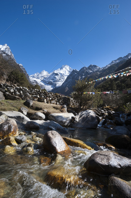 A river strewn with prayer flags near Thame in the Everest region