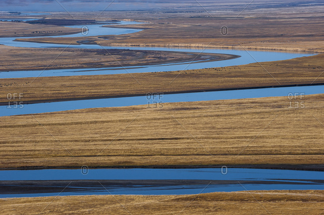 The Yellow River meanders through the open plains in Sichuan Province in China. The tiny black dots are Yaks grazing.