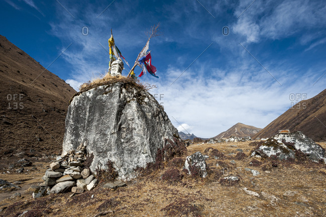 Prayer flags on top of a cairn on the Laya-Gasa trek in Bhutan