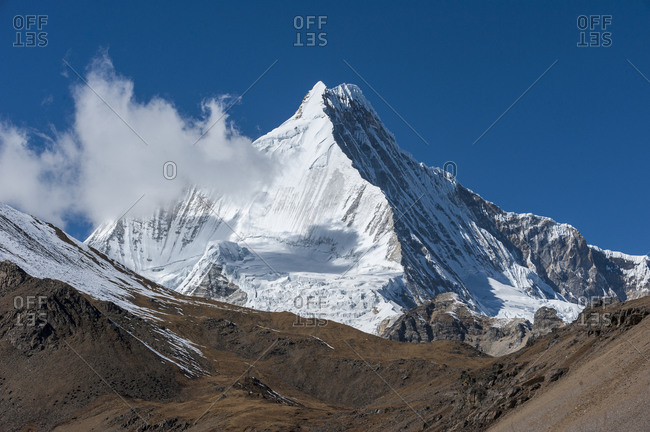 The white pyramid shape of Jichu Drake is 6662m high seen from the 4950m high Nyile La pass in Bhutan