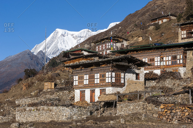 The spectacular village of Laya in Bhutan with Masagang visible behind