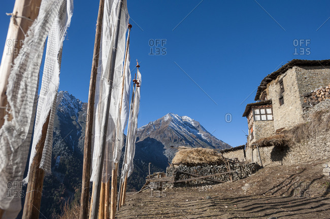 Prayer flags outside a house at the mountain village of Laya in Bhutan