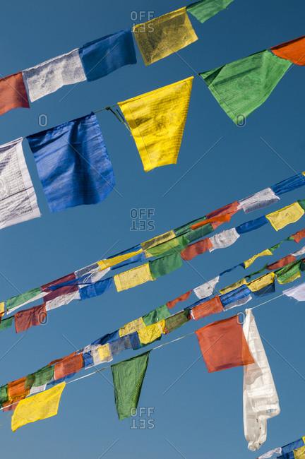 Prayer flags before a blue sky