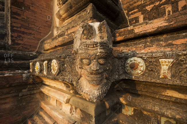 A stone head carving on the corner of one of the temples at Bagan