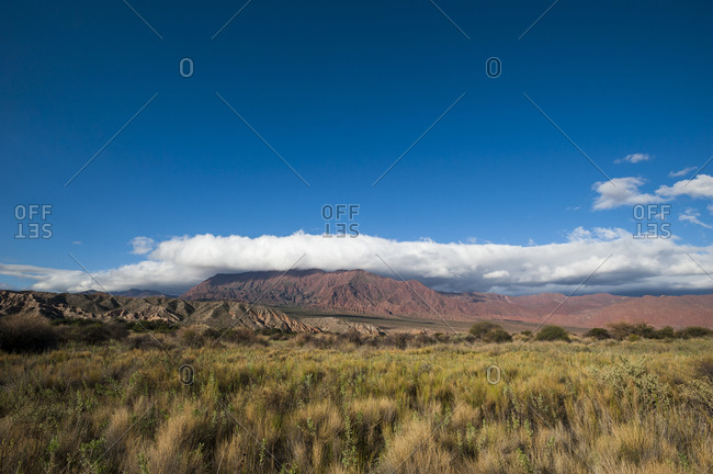 Cloud formations over red rock formations near Cafayate