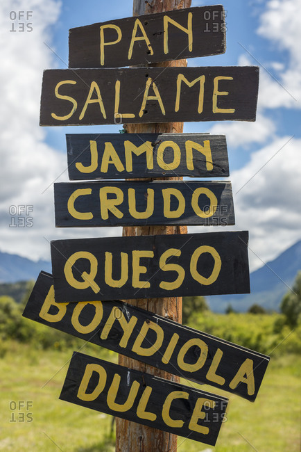A sign for a kiosk in Argentina near Bariloche selling salami, ham,  cheese and sweets