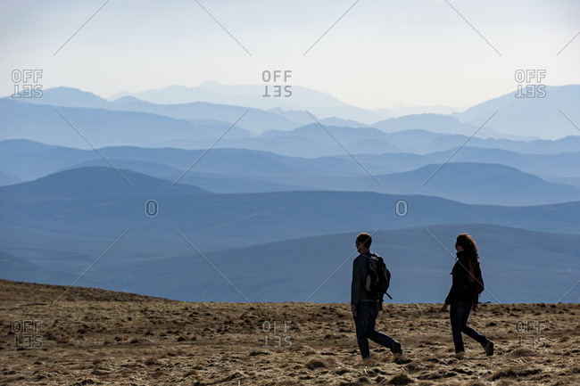 A couple walk on the fells in the Cairngorms National Park