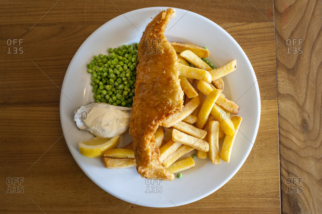 A plate of traditional British fish and chips in a  café in Scotland