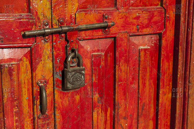 A old rusty lock on a traditional Nepali wooden door