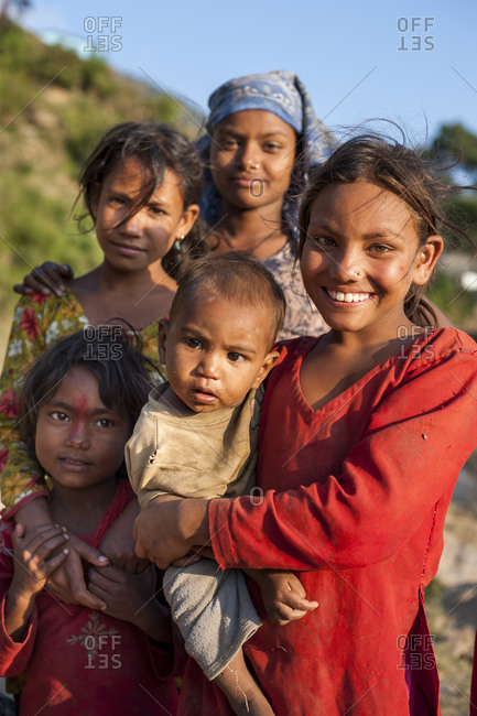 Kalikot, Karnali District, Karnali Province - October 7, 2011: A group of young children from a small village in western Nepal happily play and smile for the camera