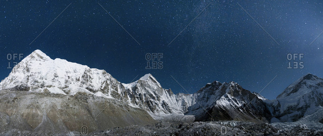 The Khumbu glacier under a night sky full of stars seen from Everest base camp