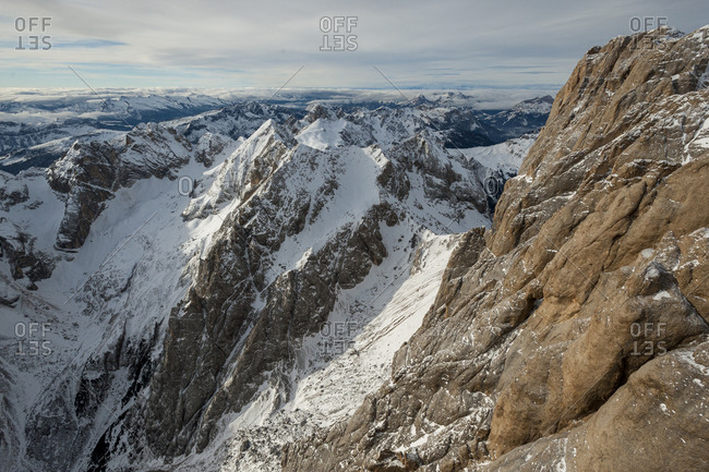 The view of the Dolomites mountains from the top of Marmolada in Italy
