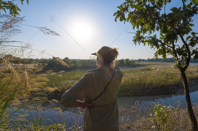 A woman looks for Rhino at Bardiya National Park in the Karnali district of west Nepal