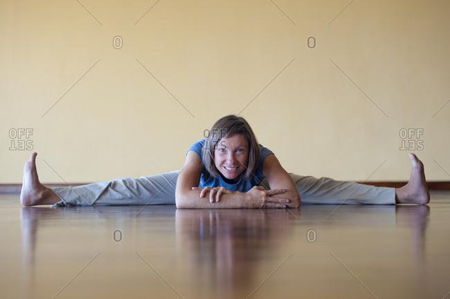 A woman does the splits in a Yoga studio in Kathmandu