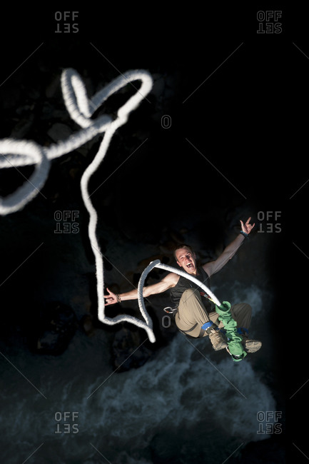 The Last Resort, Central region, Nepal - November 9, 2012: A man smiles for the camera while bouncing back on a bungee jump at The Last Resort in Nepal