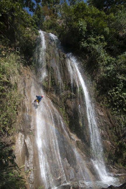Canyoning in a waterfall in Nepal