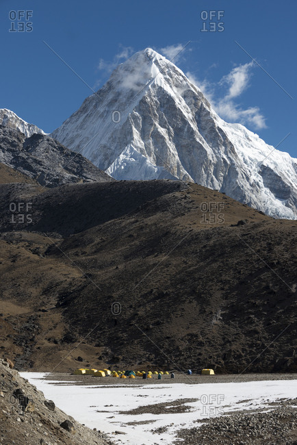 Lobuche base camp in the Everest region of Nepal with the tooth like peak of Pumori towering above
