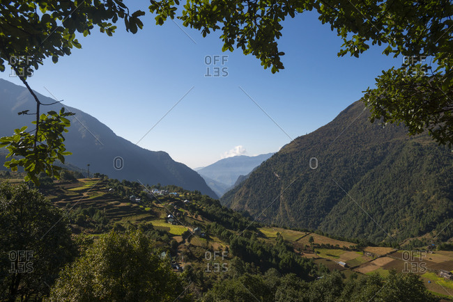 A view through the trees of Lukla valley which is a the beginning of the Everest base camp trek