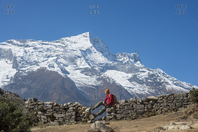 Taking a break from the trail above Namche with views of Kongde peak in the Everest region of Nepal