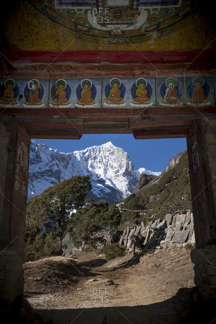 The inside of a Buddhist Kani decorated with images of Buddha. This is the entrance to Thame Gompa (monastery) in the Everest region of Nepal